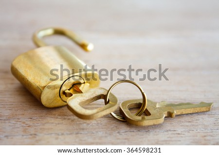 Golden padlock on wood background