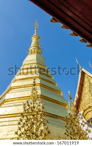 Golden Pagoda at Wat Phra That Cho Hae (the Royal Temple), Phrae Province, Thailand - stock photo