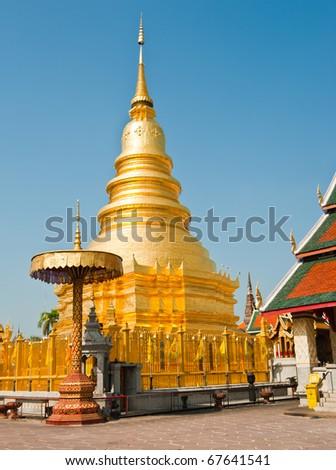 Golden Pagoda at Wat Phra That Hariphunchai , Lamphun Province, Thailand - stock photo