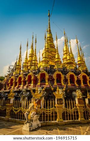 Golden pagoda at Wat Phra That Su Thon Mongkhon Khiri Samakkhi, Phrae Province, Thailand. - stock photo