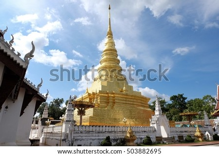 golden pagoda in front the sanctuary, Nan, Thailand