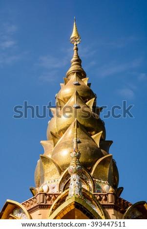 Golden Pagoda on blue sky - stock photo