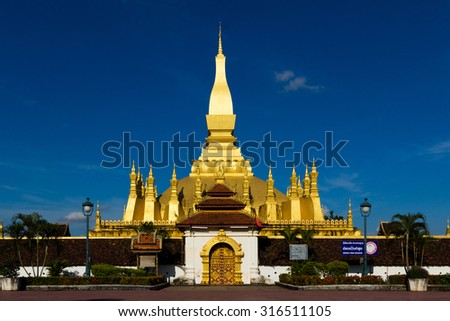 Golden pagoda wat Phra That Luang in Vientiane, Laos. They are public domain or treasure of Buddhism, no restrict in copy or use - stock photo