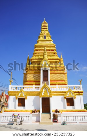 Golden pagoda with blue sky in Thailand. - stock photo