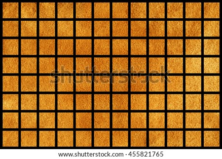Golden painted squares on black background.