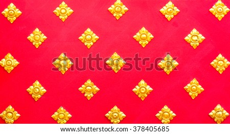 golden pattern carvings on wooden red of thai style - stock photo