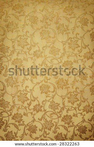 Golden pattern on wallpaper. Ideally as background - stock photo