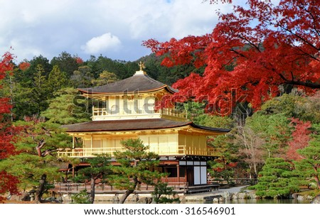 Golden Pavilian at Kinkakuji Temple with red leaves in Autumn season - stock photo