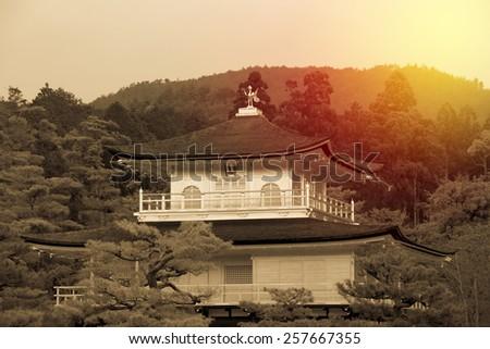 Golden Pavilion Kinkakuji Temple in Kyoto Japan. Vintage filter - stock photo