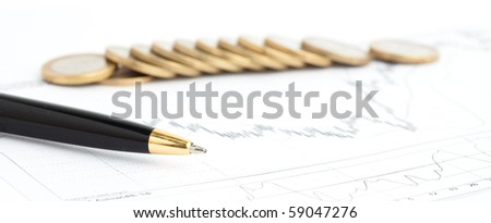 golden pen and coins on chart background - stock photo