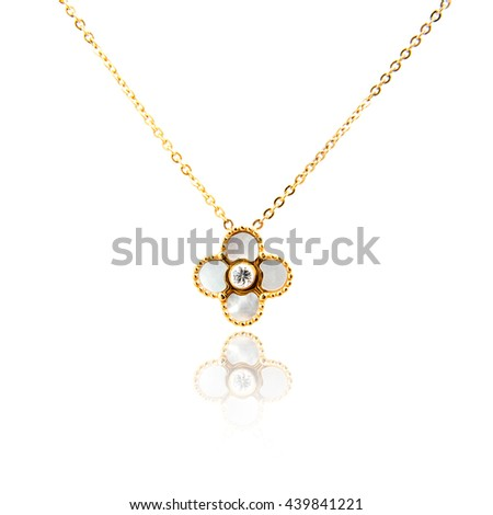 Golden pendant isolated on white