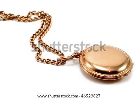 Golden pendant on golden chain isolated on white - stock photo