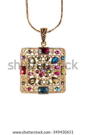 Golden pendant with gems on a chain isolated over white - stock photo