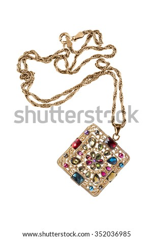 Golden pendant with gems on white background - stock photo