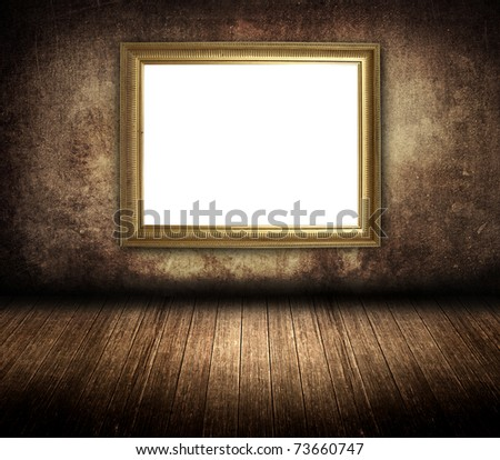 golden photo frame in old room - stock photo