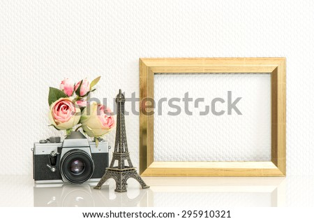 Golden picture frame, rose flowers and no name vintage camera. Retro style decoration with space for your photo or text. Paris travel concept - stock photo
