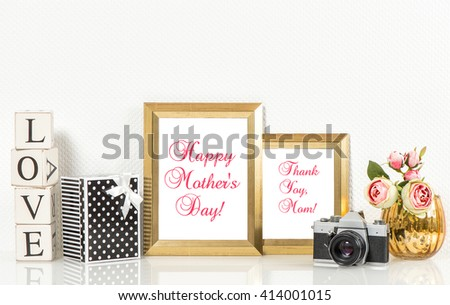 Golden picture frames, roses flowers and no name vintage camera. Copy space for Your designs. Happy Mothers Day! Mothers Day greetings card. Mothers Day concept. Mother's Day. Mothers Day gift - stock photo