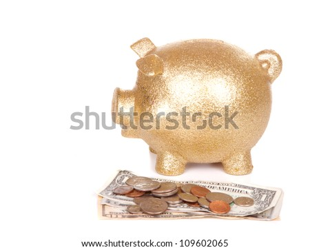 Golden piggy bank and money on white