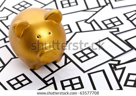 Golden Piggy Bank, Real Estate Concept - stock photo