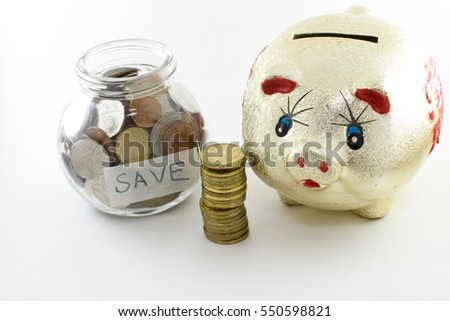 Golden piggy bank with Chinese character. Money in a glass jar. White background.