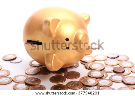 Golden piggy bank with savings in coins on white background