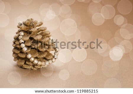 golden pinecone as a christmas tree - stock photo
