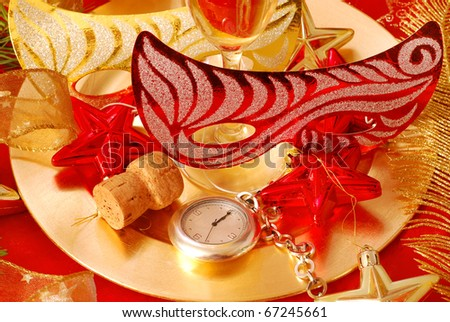 golden plate with glasses of  champagne and pocket watch showing  few seconds to New Year - stock photo