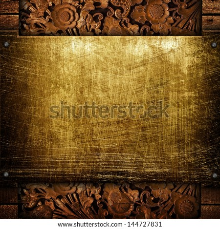 golden plate with wooden frame