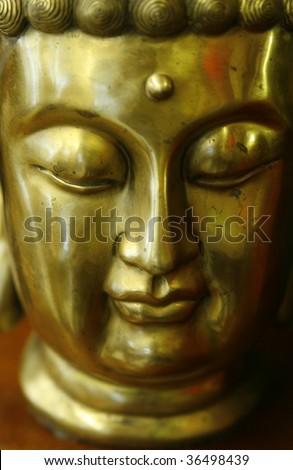 Golden portrait of holy buddha - stock photo