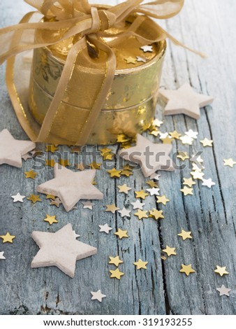golden present with little stars,  - stock photo