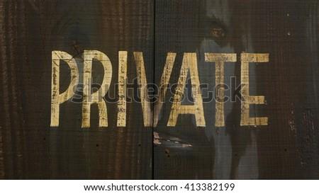 Golden 'Private' Wording on Grunge Wood Door Texture - stock photo