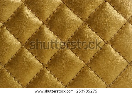 Golden Quilted Leather Background - stock photo