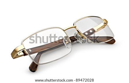 golden reading glasses isolated on white