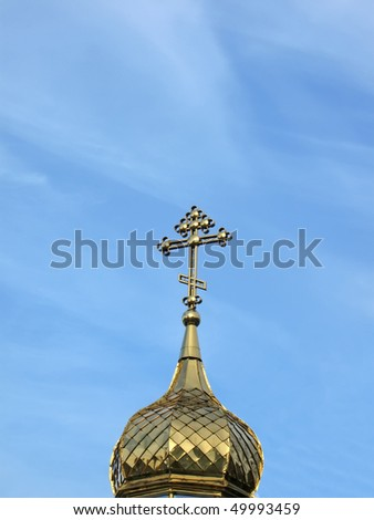 golden religious sign on blue sky with white clouds. new holy bible concept - stock photo