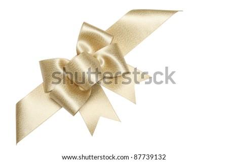 Golden ribbon bow isolated on white. - stock photo