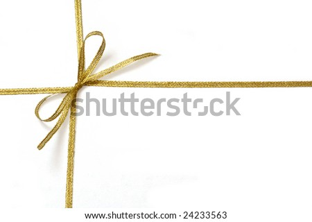 Golden ribbon with bow isolated - stock photo