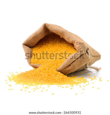 Golden rice on white background - stock photo
