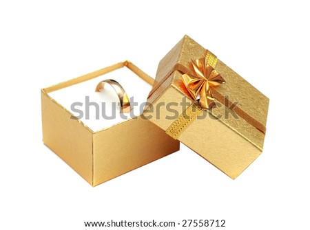 golden ring in gift box isolated on white - stock photo