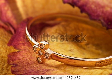 "Golden ring with an ornament in the form of a cross. An inscription sideways "" rescue and keep """