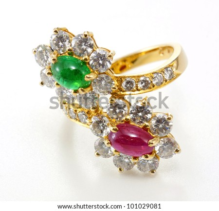 Golden Ring with Diamond and gemstone on white background. - stock photo