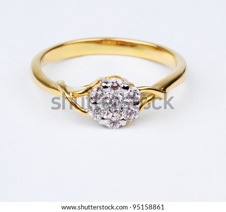 Golden ring with diamond, Isolated on white background - stock photo
