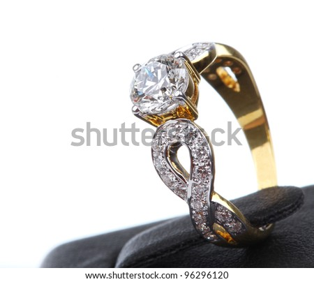 Golden Ring with Diamond on base, Isolated on white background. - stock photo