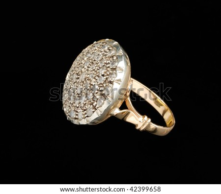 Golden ring with diamonds over black background - stock photo