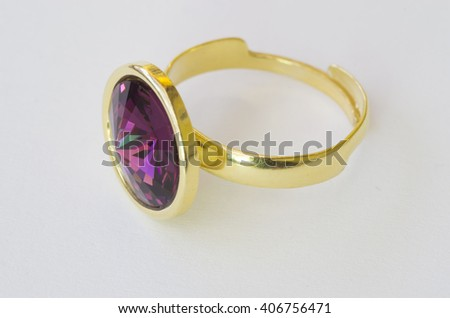 Golden ring with purple gem stone - stock photo