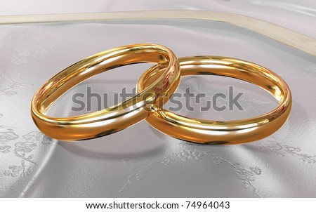 golden rings over a delicate satin