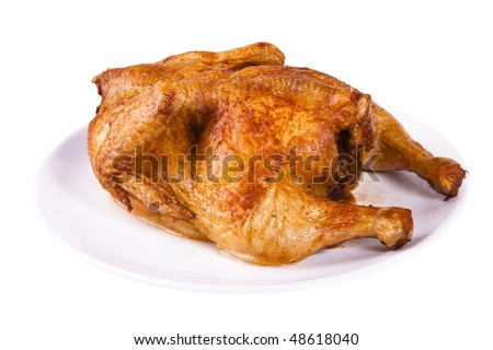 Golden roasted chicken on white plate  isolated on a white background. - stock photo