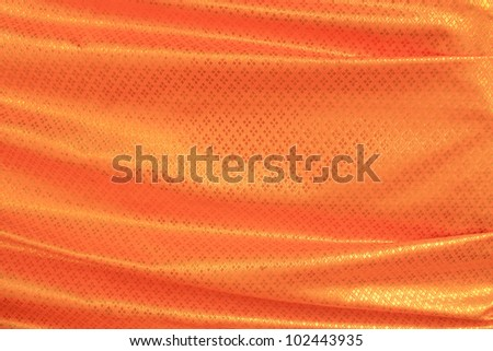 Golden robe in buddhist temple in Thailand. wrapped around a big tree. - stock photo
