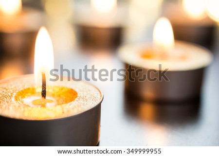 Golden Romantic Candlelights In Bright X-Mas Atmosphere On Wooden Table With Bokeh - stock photo