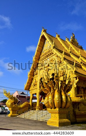 golden sanctuary and Naga statue,  in Nan, Northern of Thailand, blue sky, blue sky cloud - stock photo