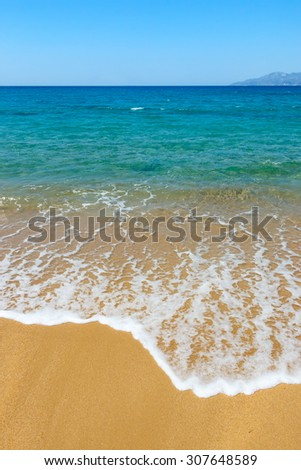 Golden sand and azure sea on Ios island, Greece - stock photo
